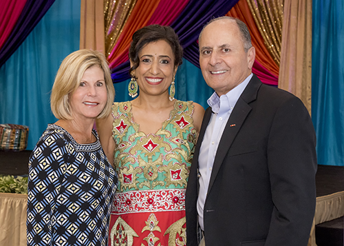 Denise and John with Poonam Maini at her benefit event for Share Care Global