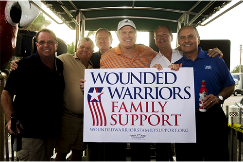 John with Terry Bradshaw, and others, rasing money for Wounded Warriors